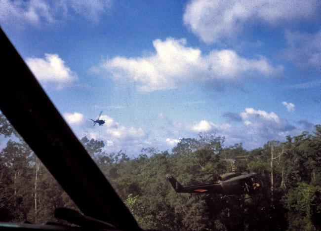 A helicopter gunship pulls away after making a firing pass
