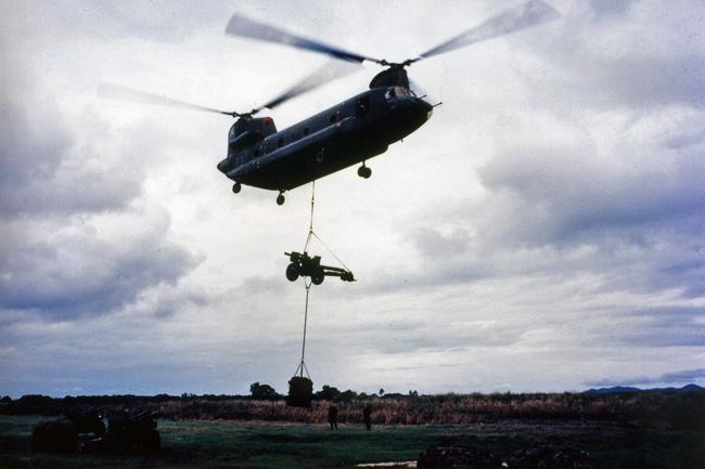 Chinook lifting gun at Nui Dat, circa 1968-1969