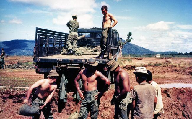 Loading sandbags on truck, circa 1968-1969