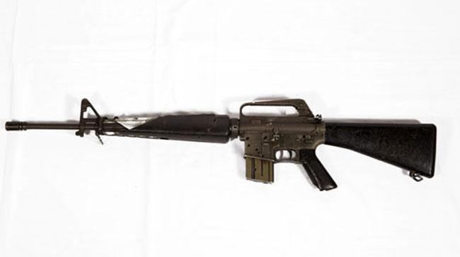 Battle damaged M16 automatic rifle