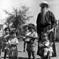 Father Olivier and children at Binh Loi Orphanage