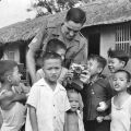 SSgt Graham (Dick) Grigg with Vietnamese orphans