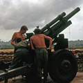 Preparing to fire M101A1 Howitzer, circa 1966-1967