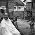 Ken Treanor receives haircut in Montagnard village, circa 1968