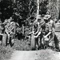 Vietnam veterans Toi Rawire (left foreground) and Jeffery Waters (right foreground) during an artillery exercise in Fiji